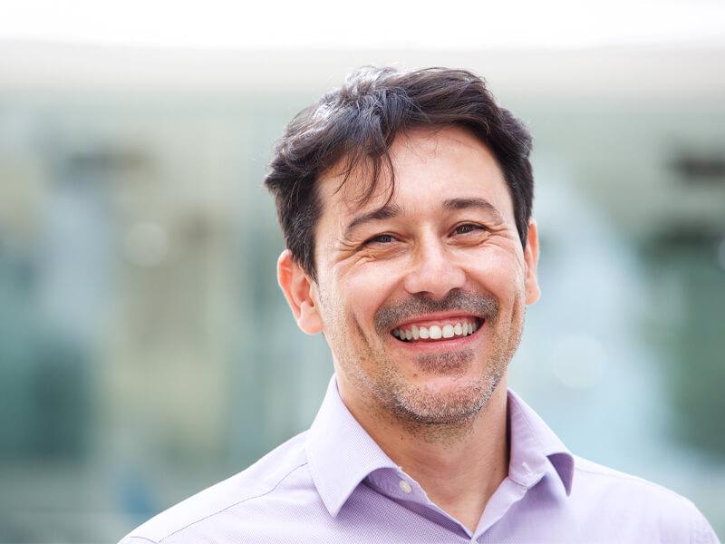 Man smiling after a dental crown procedure