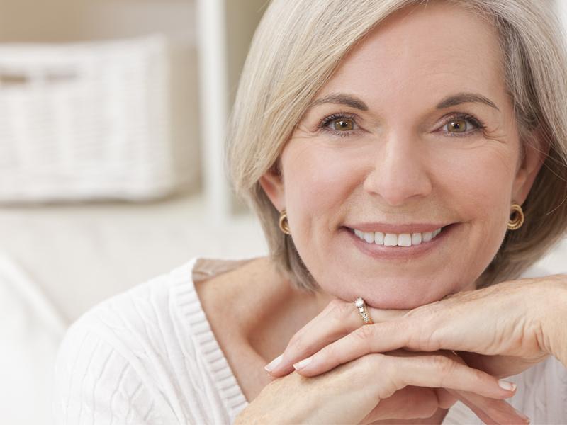 Older Woman Enjoying Her Dentures