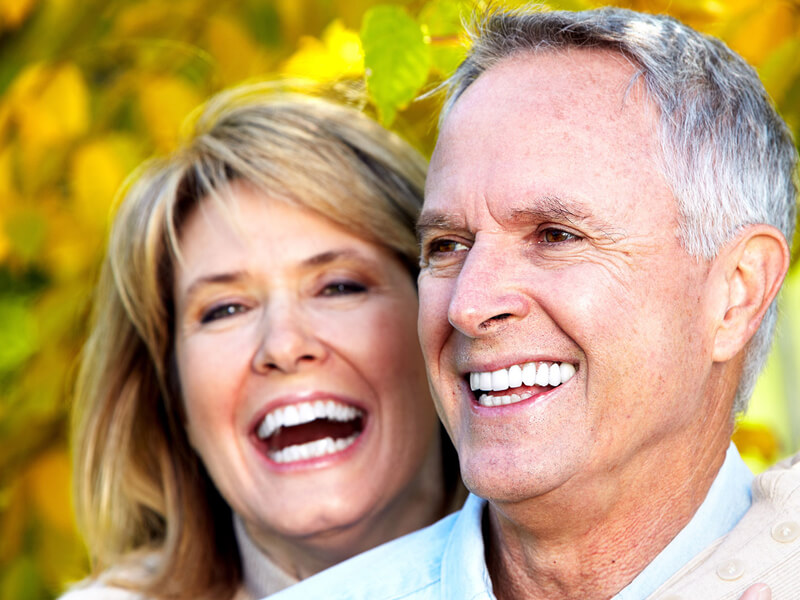 Smiling Couple With Implants From Bone Grafting