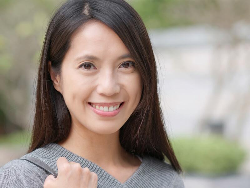 Woman smiling after Dental Bridgework