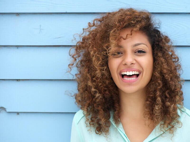 Women Smiling After Veneer Treatment