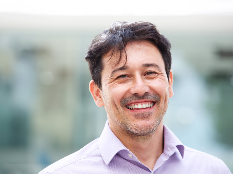 Man smiling after a screening of oral cancer