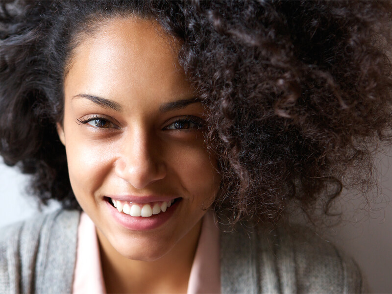 Woman Smiling After Pocket Irrigation Treatment