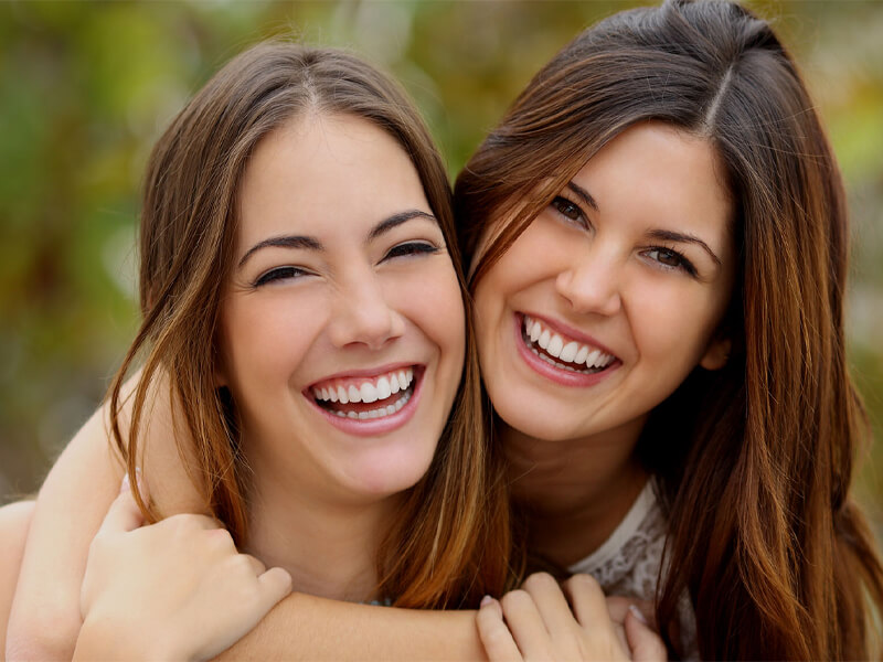2 Woman Smiling After seeing General Dentist