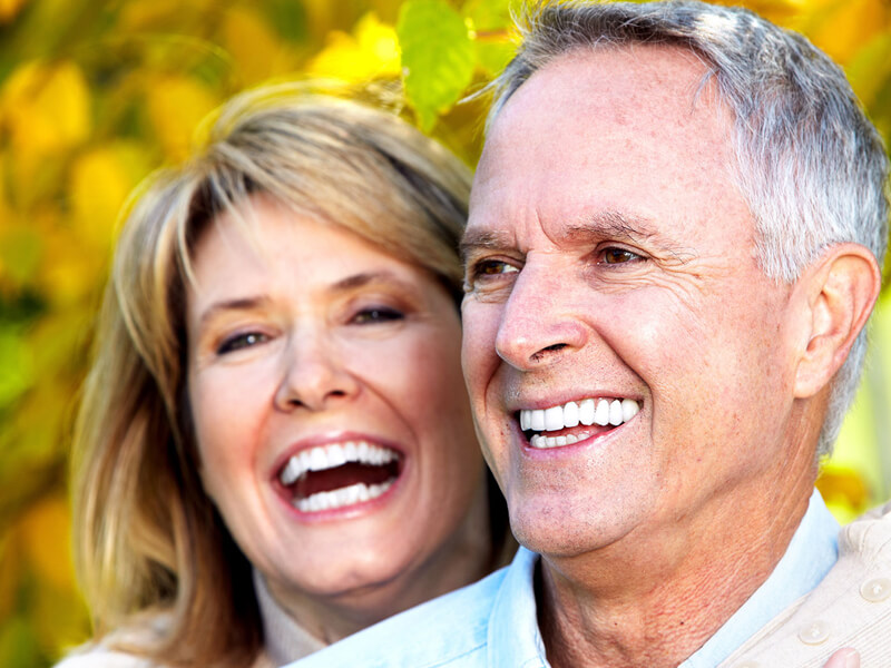 Couple Smiling After Oral Surgery