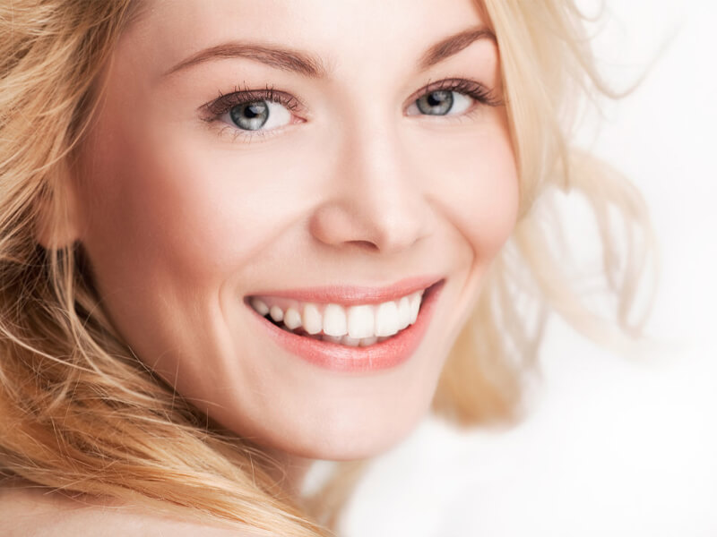Woman Happy After a Common General Dental Procedure