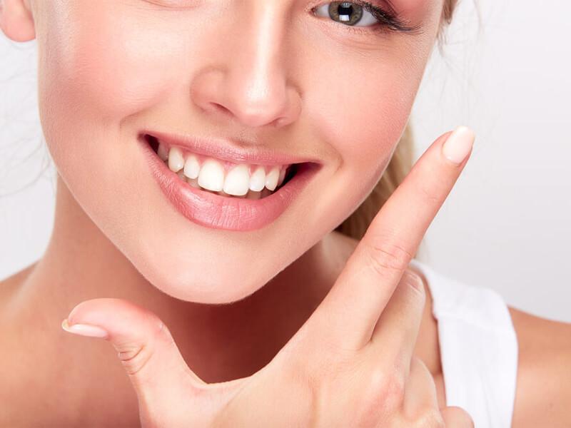 Woman Showing Off Smile Restorative Dental Procedure